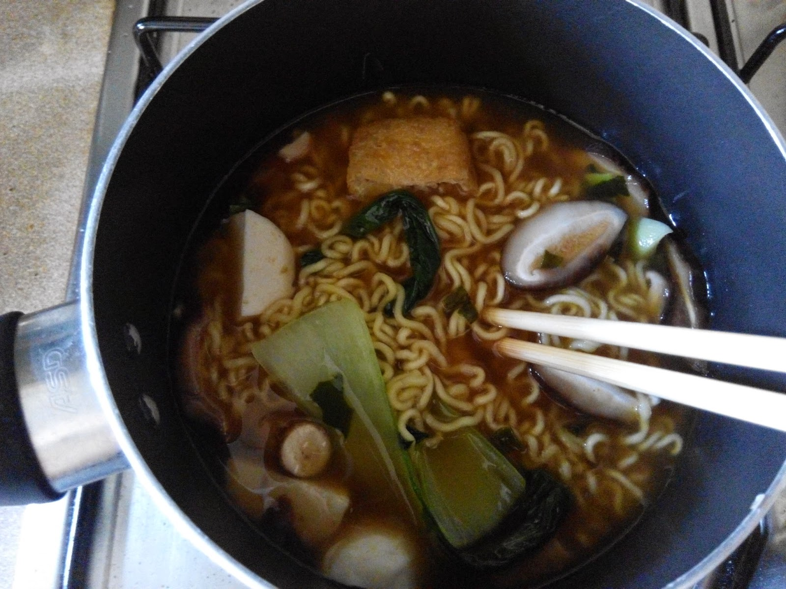 Instant noodles in a pot with different toppings
