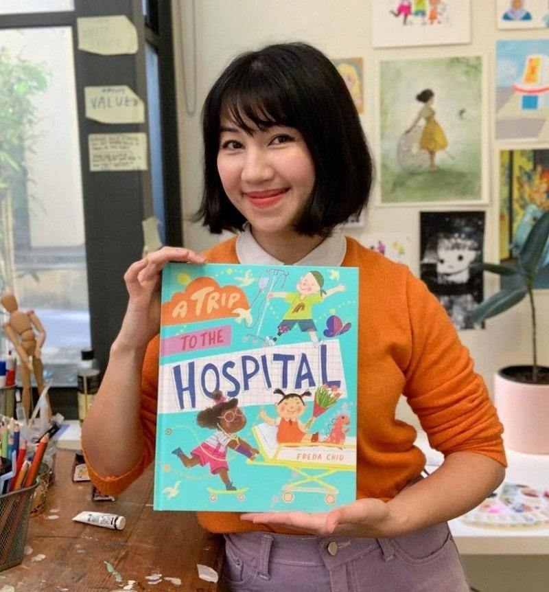 author freda chiu holding her new book a trip to the hospital