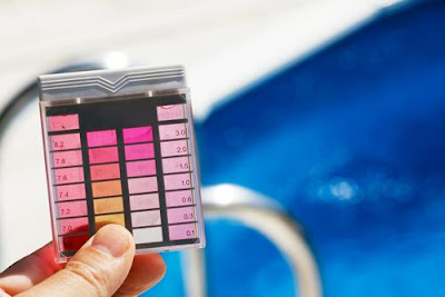 Image of pool testing kit. Swimming, Skin and Pool Chemicals concerns