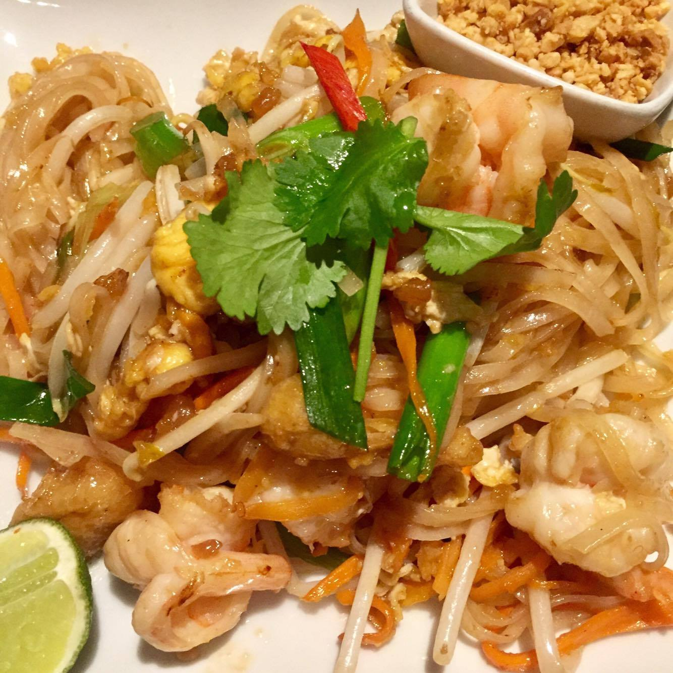 traditional pad thai with prawns, peanuts and lime