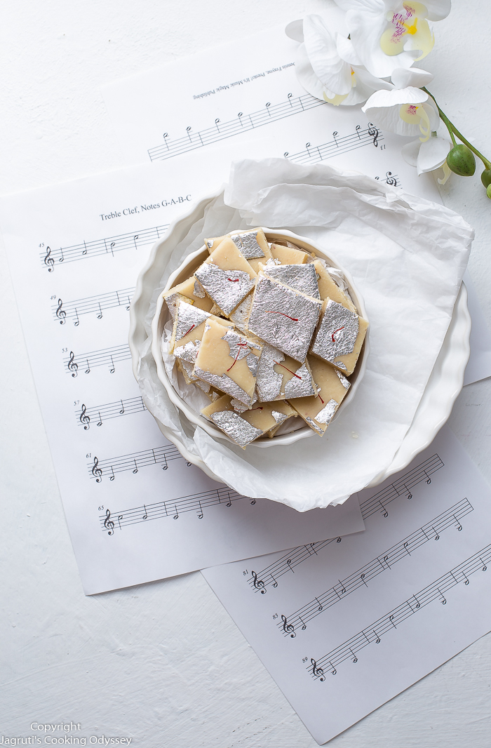 Singadana barfi served in a plate, plate is placed on music notes papers.