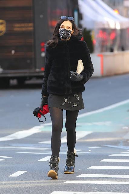 Famke Janssen – Wearing a Black Faux Fur Puffer Jacket with a mini-skirt in Manhattan
