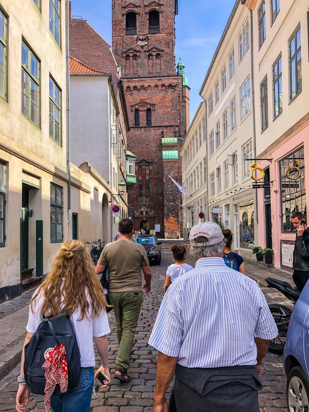 Copenhagen itinerary free walking tour group through Copenhagen street