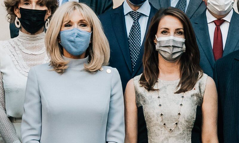 Princess Marie wore a metallic jacquard dress from By Malene Birger. Brigitte Macron wore a blue top and skirt by Louis Vuitton