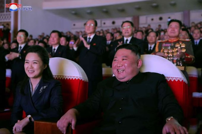 Wife of North Korea's Kim makes first public appearance in a year