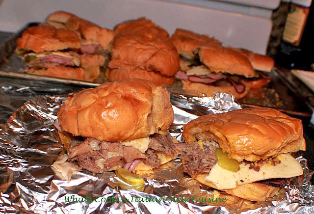 these are pork sandwich made cuban style with pickles mustard pork and ham