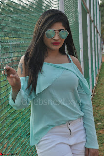 Madhulagna Das looks super cute in White Shorts and Transparent Top 10.JPG