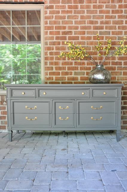 gray dresser with brass hardware