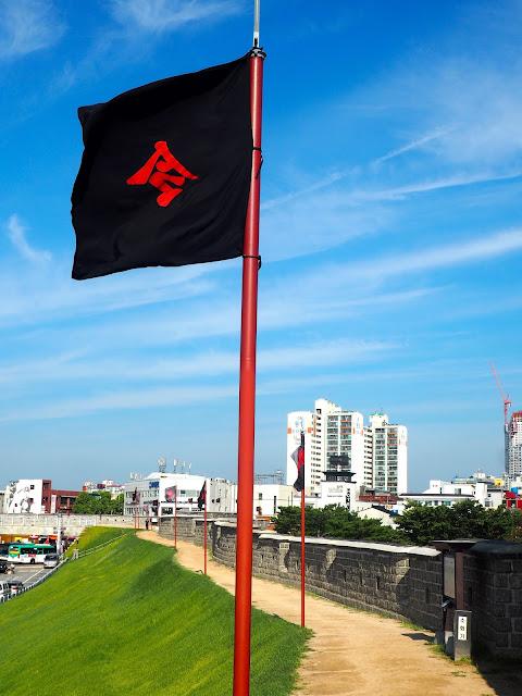 Black flags on the Hwaseong fortress walls around Suwon, Gyeonggi-do, South Korea