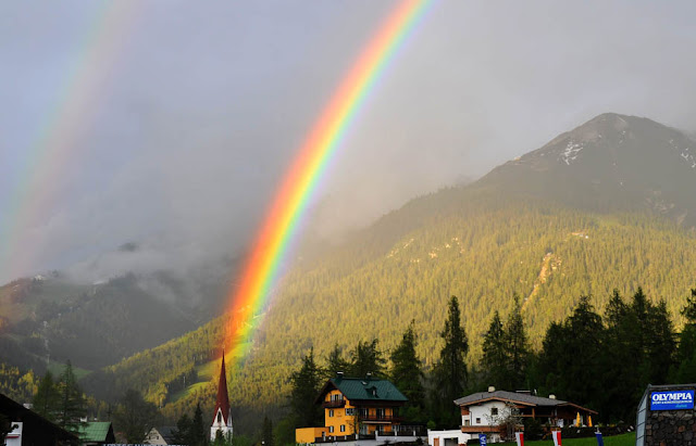 A rainbow is seen over Seefeld, Austria