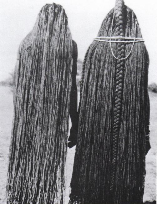 Two women whose braids have been lengthened to their ankles through the use of sinew eefipa extensions, Mbalantu of Wambo group, Namibia, Africa Photo: M.Schettler, 1940's
