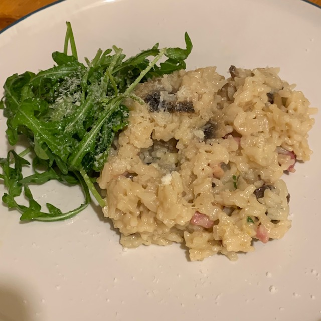 Bacon and mushroom risotto, with a side of dressed rocket