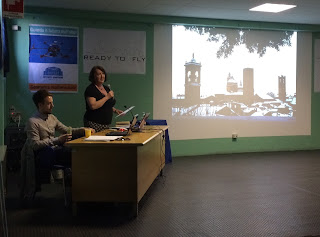Val Culley talking about one of her books to an audience in the city of Bergamo, in Italy
