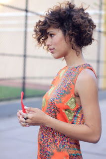 Short messy curly hairdo