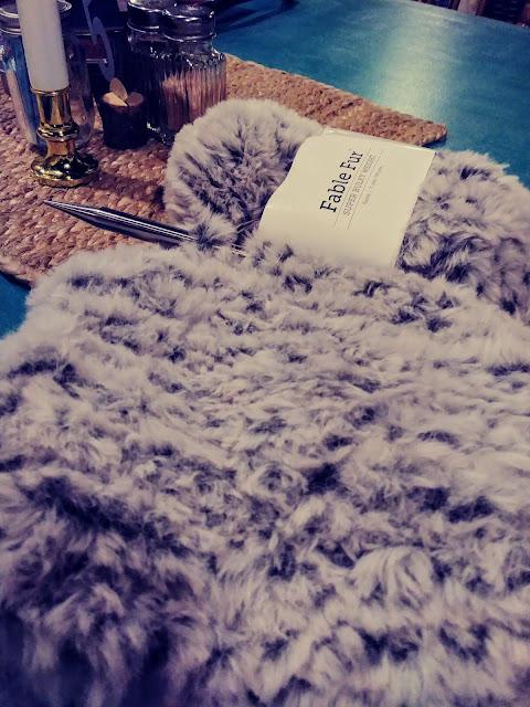 Knit a super fast, super easy faux fur cowl. http://shrsl.com/1tt0p