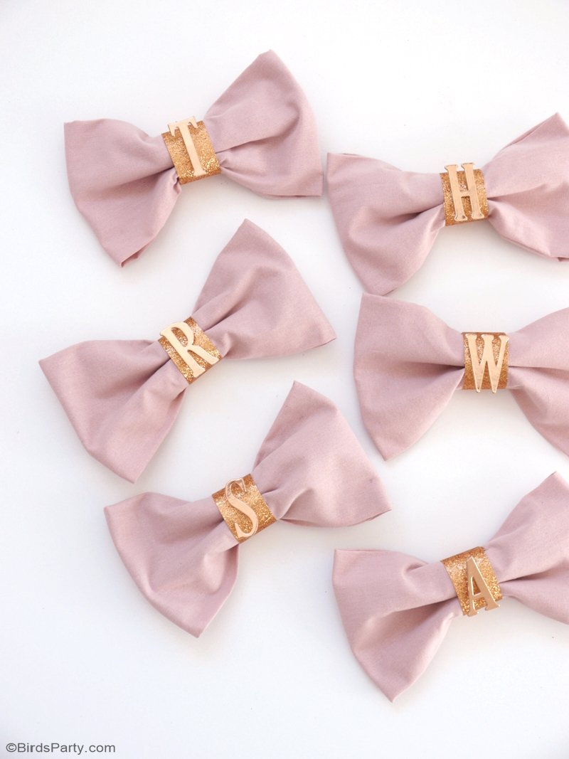 DIY Pink Bow Napkins & Copper Monogram Napkin Rings - learn to craft these quick and easy napkins for your holiday party tables! by BirdsParty.com @birdsparty #diy #christmasdiy #pinkchristmas monogramnapkins #diynapkinrings #copperdiy #pinkcopperparty