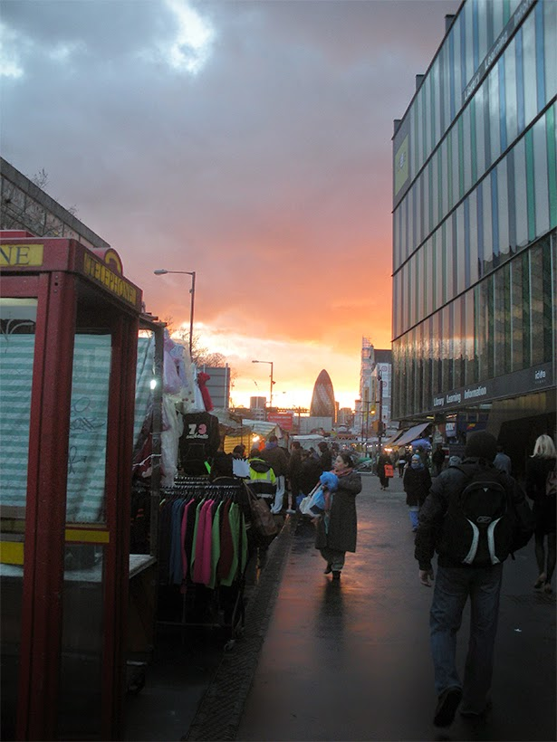 Mile End Road and the Gherkin at sunset
