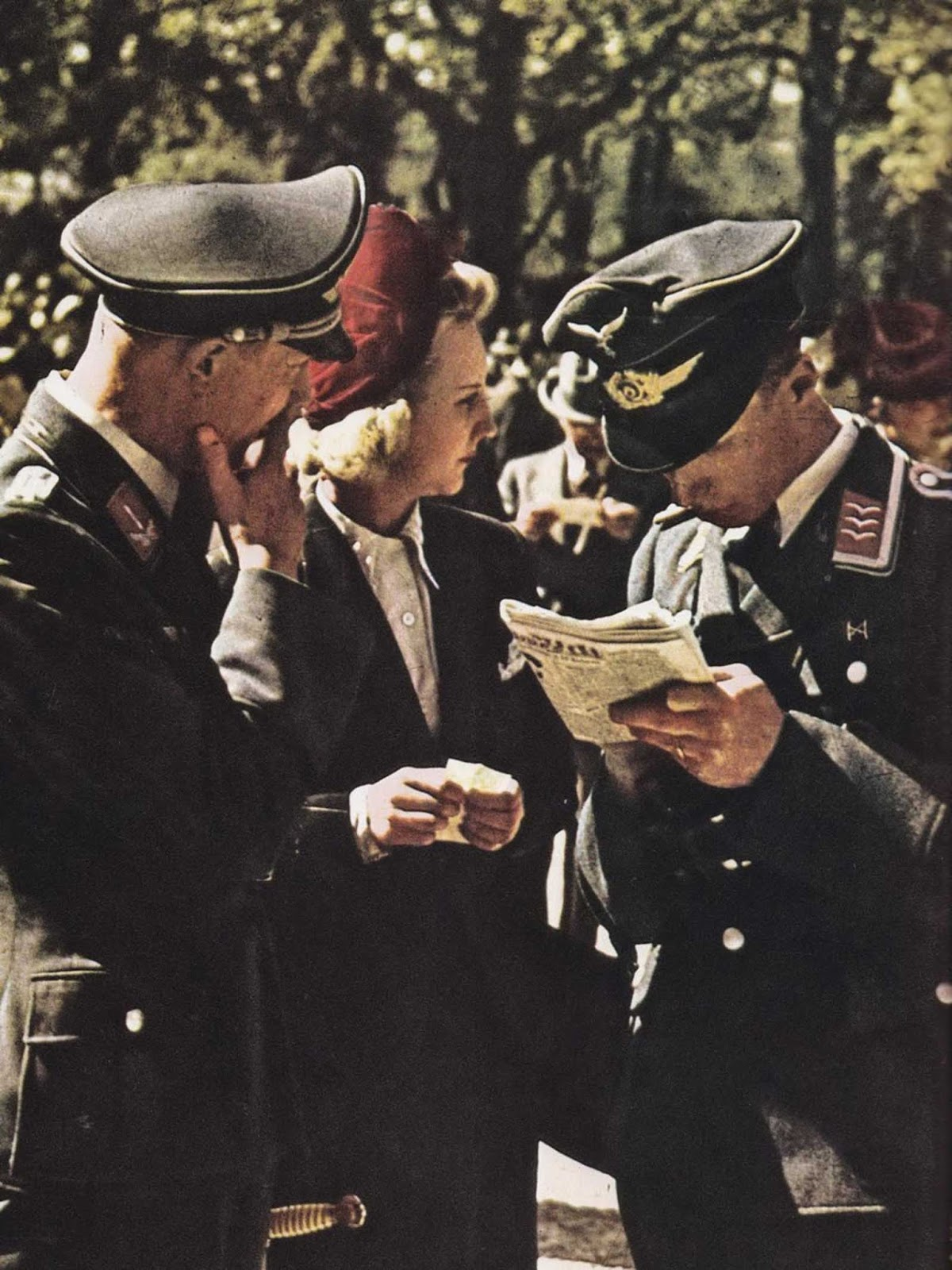 German officers talking to a blonde lady.