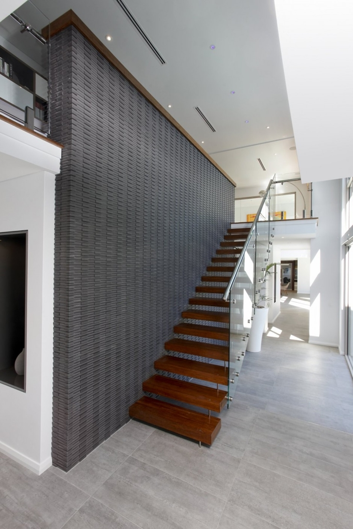 Modern stairs in Contemporary style One27 Grovedale home by Mick Rule