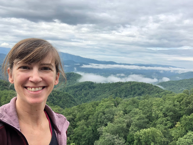 woman in front of mountain overlook