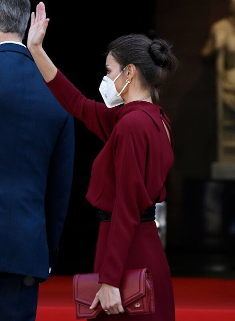 Queen Letizia wore a limited edition burgundy red open back dress from Massimo Dutti