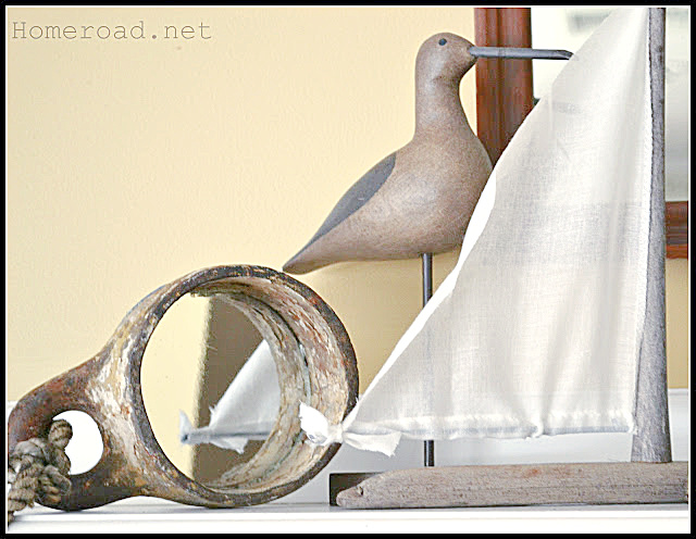 mirror, bird and driftwood sailboat