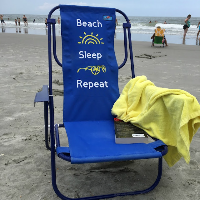 Make your plain beach chair stand out in a sea of chairs by customizing it with iron on and a Cricut EasyPress!