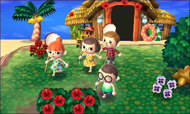 """أربع شخصيات أمام منزل على الشاطئ في """"Animal Crossing: New Leaf""""."""