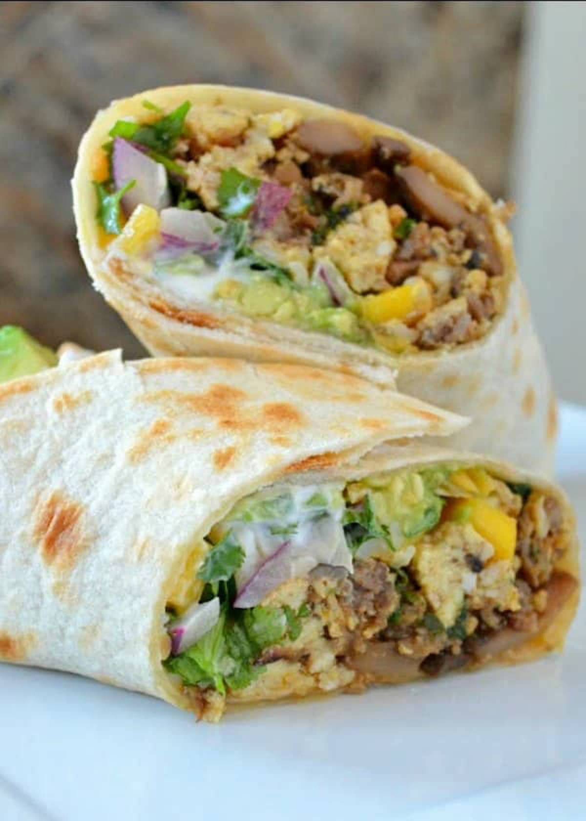 Breakfast Burrito recipe filled with potatoes, sausage or bacon with hidden veggies are a favorite breakfast recipe for on the go.