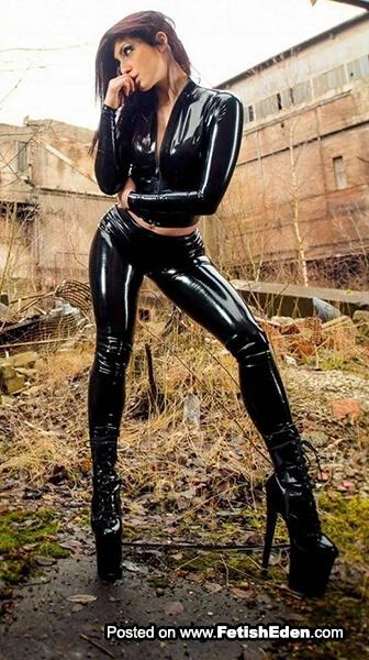 Black latex leggings lady with auburn hair in black latex top