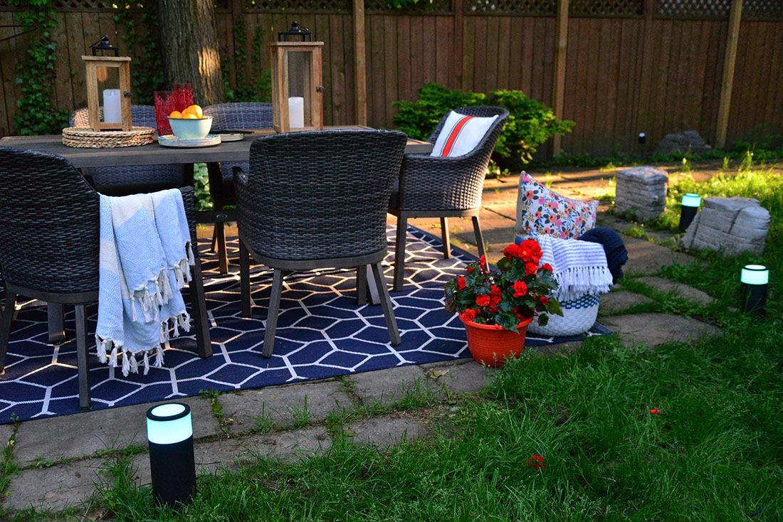 outdoor backyard dining, summer entertaining tips, philips hue outdoor bollard and spotlights