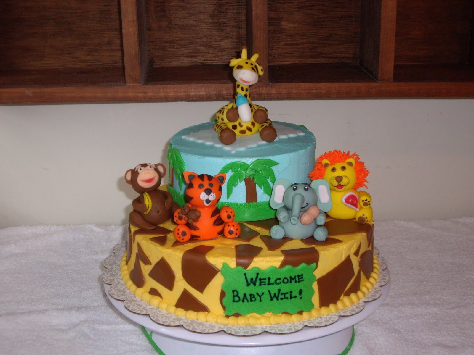 Animal theme baby shower cakes