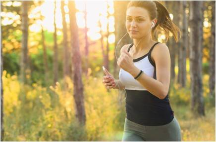 A woman running while listening to music.