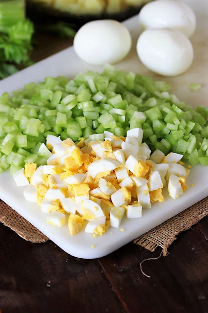 Chopped Hard-Boiled Eggs and Chopped Celery On a Cutting Board Image