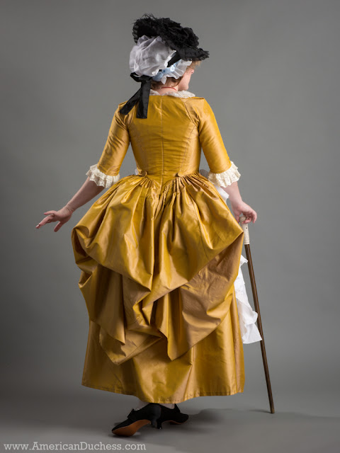 8bf8581eaa2 Italian Gown in yellow silk taffeta worn with a ruffled voile apron and  cap