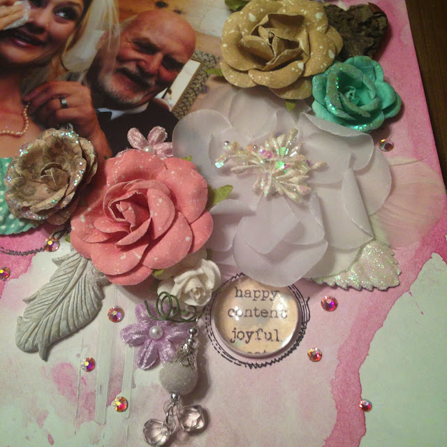String of Pearls by Alice Scraps Wonderland | Soft watercolors and white gesso create a beautiful background for Prima Marketing flowers, a resin feather and velvet trinket bauble.