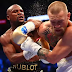 "Breaking News: Boxing – Floyd Mayweather Jr. Knocks Out ""Beats"" Conor McGregor in 10th Round, see photos"