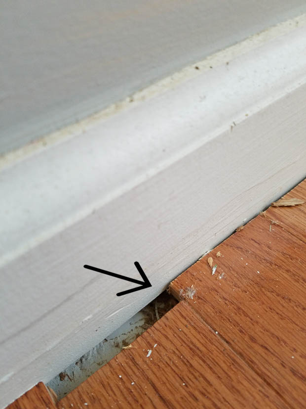 how to remove baseboard that is trapped by hard wood floors