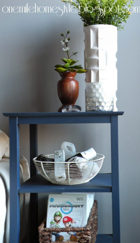 Pretty video game storage - navy shelves with wire and natural baskets