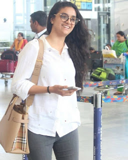 Keerthy Suresh in White Dress with Cute and Awesome Lovely Smile at Hyderabad Airport 2
