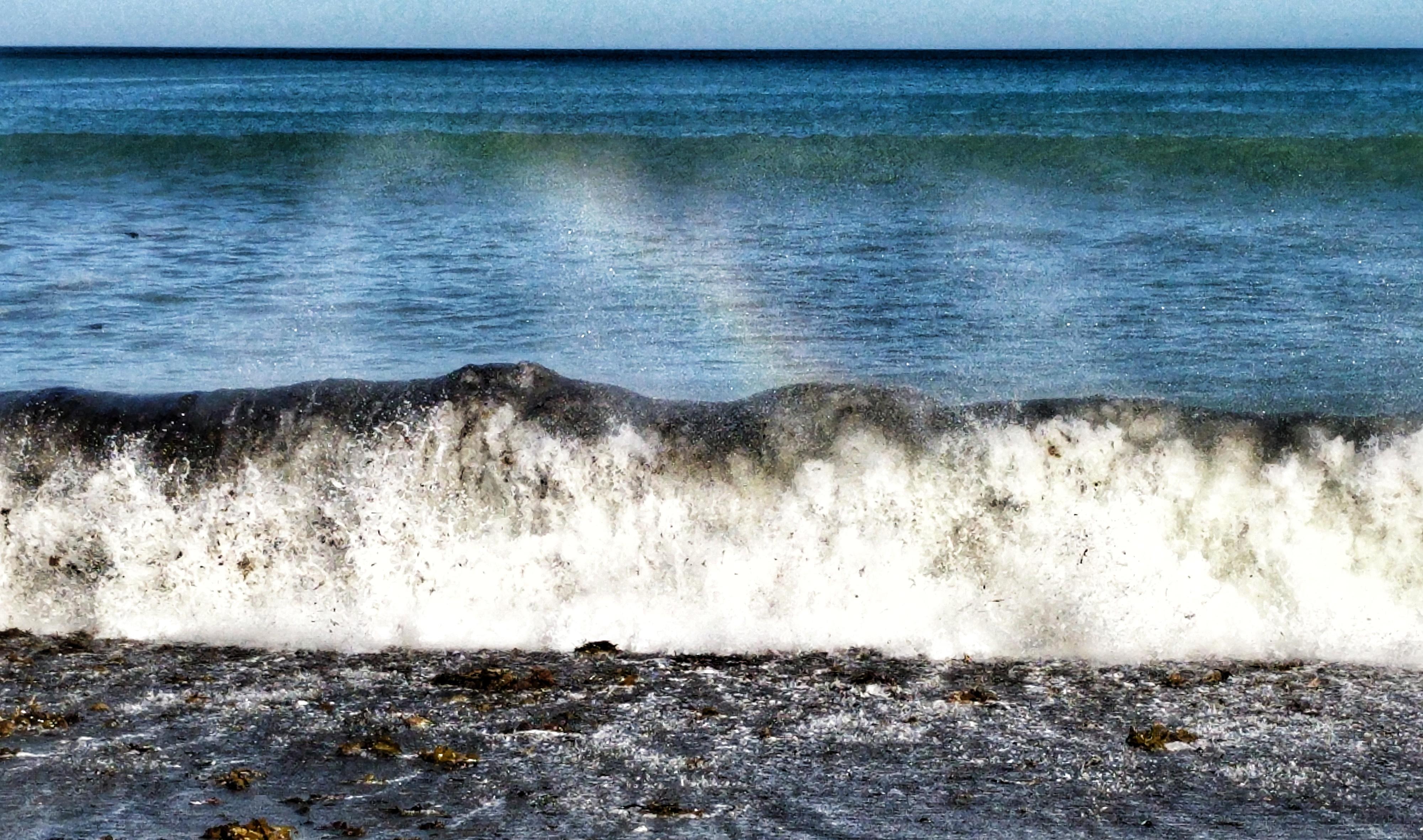 Wave break creates a tiny rainbow