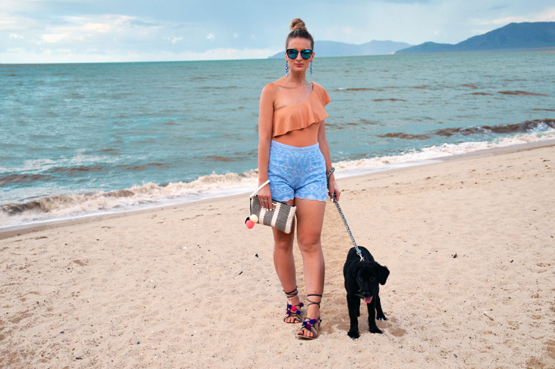girl on beach walking cute puppy
