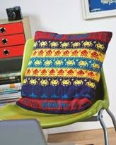 http://www.letsknit.co.uk/free-knitting-patterns/retro-arcade-games-cushion