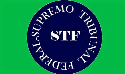 Imagem numa forma de carimbo está em círculo, inscrito: STF Supremo Tribunal Federal. decide que a vacina contra a covid-19 é obrigatória.