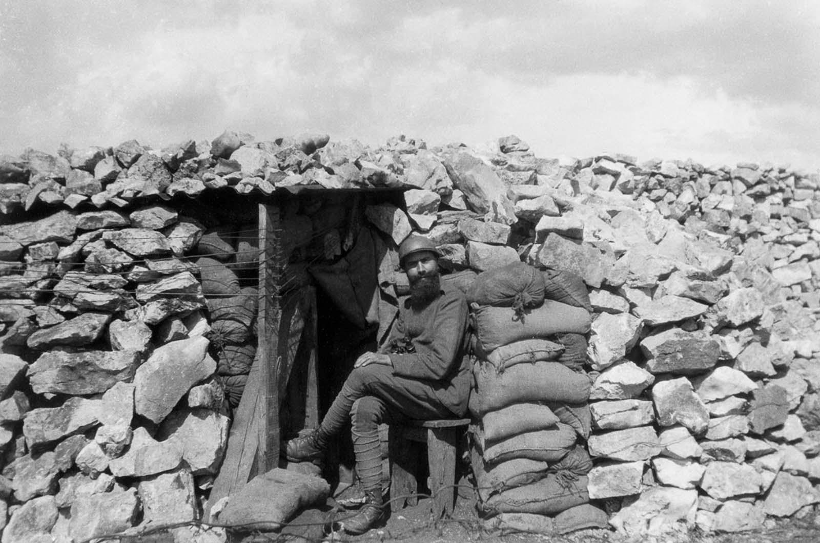 An Italian soldier outside a mountain bunker. 1916.
