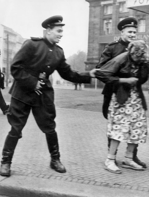 Soviet soldiers sexually harass a German woman in Leipzig, Germany, August 1945.