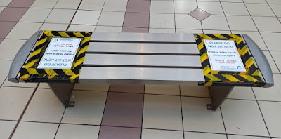 Bench in the Spinning Gate shopping centre in Leigh