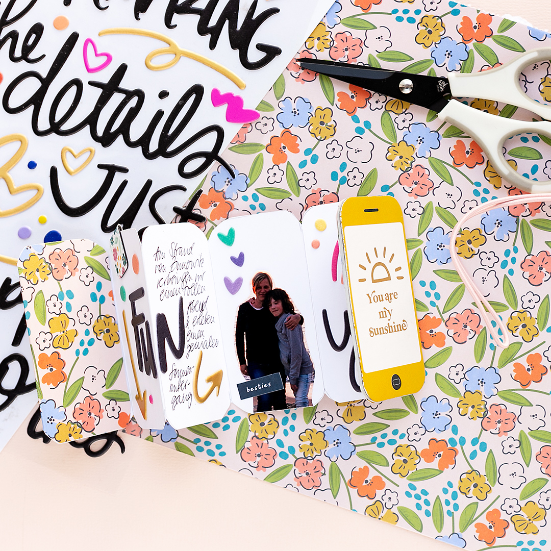 Decorate tiny mini album with word stickers and small photos American Crafts Papercrafting Jen Hadfield Reaching Out