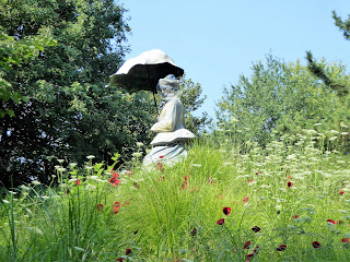 Sculpture of female carrying umbrella
