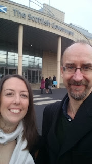 Photos of Dr Hayley Bennett and Dr Richard Brunner outside the Scottish Government building at Victoria Quay